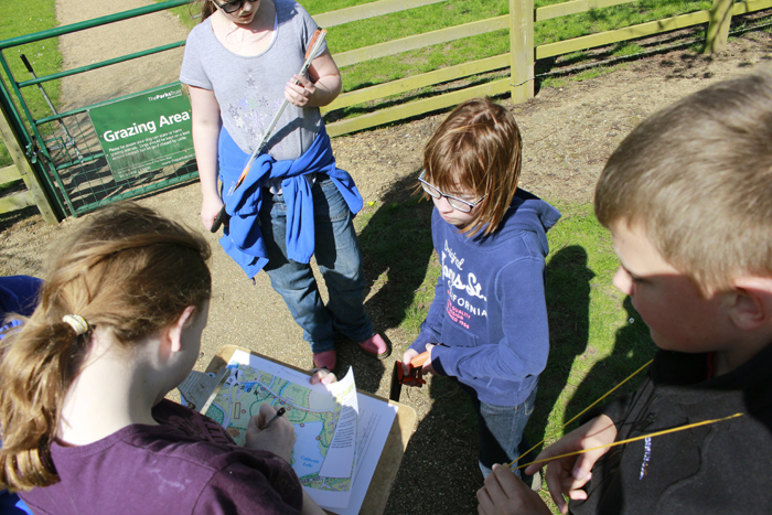 Young people using a map to navigate around the Ouzel Valley Park at Woughton-on-the-Green